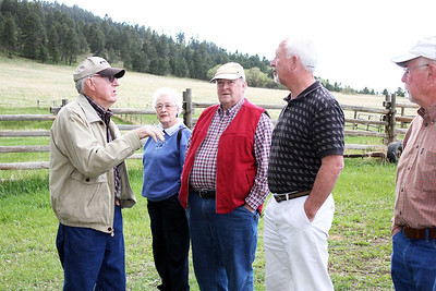 Hank Frawley (left) provides insight to the history of the James Anderson Homestead.