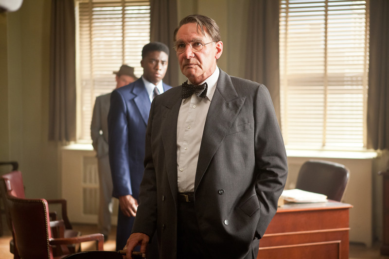 """. (L-r) CHADWICK BOSEMAN as Jackie Robinson and HARRISON FORD as Branch Rickey in Warner Bros. Pictures� and Legendary Pictures� drama �\""""42\"""" a Warner Bros. Pictures release."""