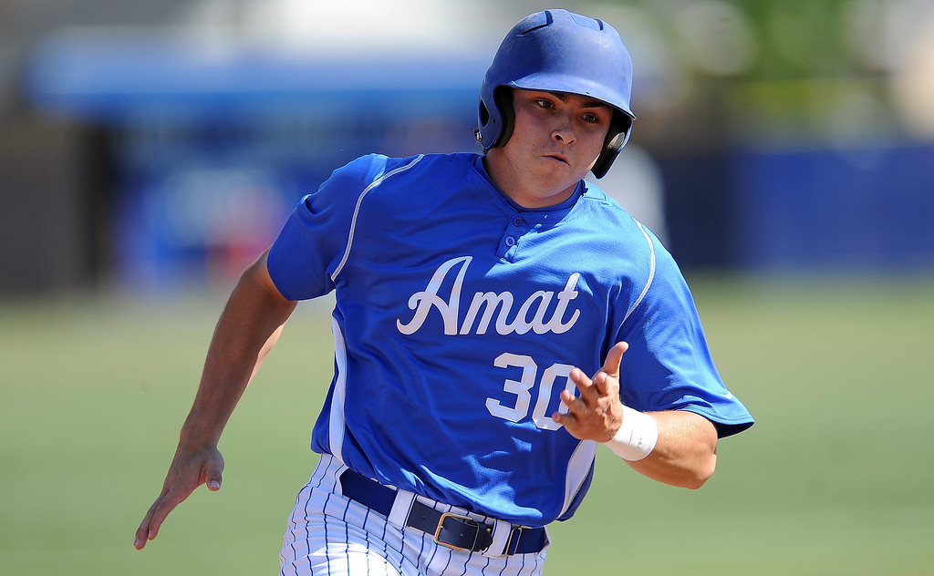 . Bishop Amat\'s Adam Alcantara scores on a triple by Bryan Menendez (not pictured) in the first inning of a prep baseball game against St. Paul at Bishop Amat High School on Friday, April 19, 2012 in La Puente, Calif. Bishop Amat won 3-2.    (Keith Birmingham/Pasadena Star-News)
