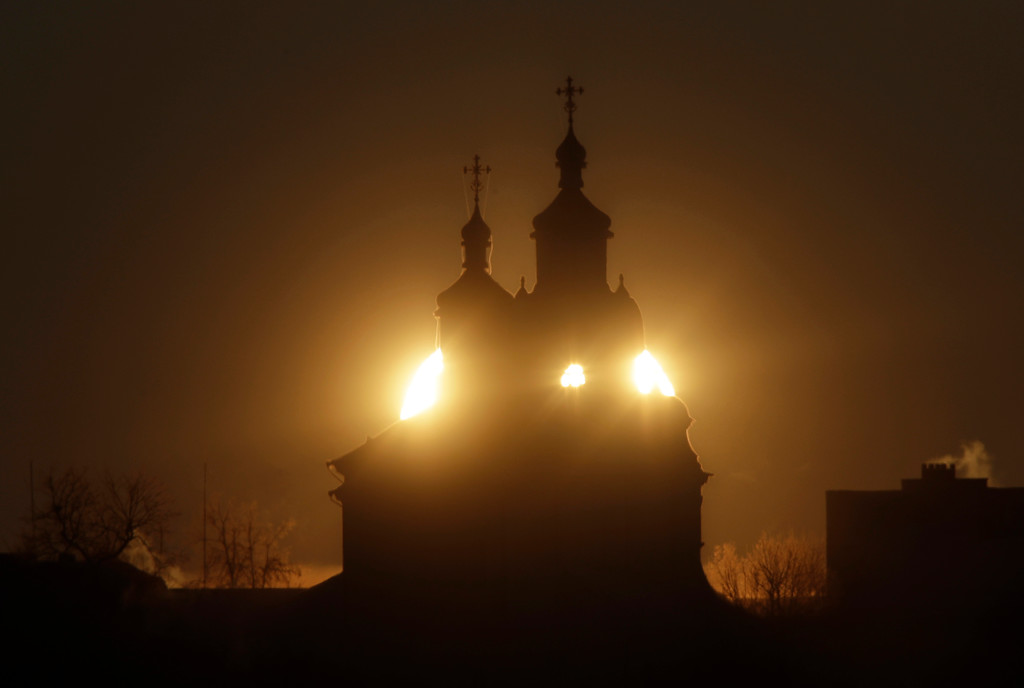 . The sun rises above the Orthodox Church in the town of Novogrudok, 150 kilometers (93 miles) west of Minsk, the capital of Belarus, Saturday, Jan. 7, 2017. Morning temperatures dropped around -19 degrees Celsius (-2 degrees Fahrenheit) in Belarus. (AP Photo/Sergei Grits)