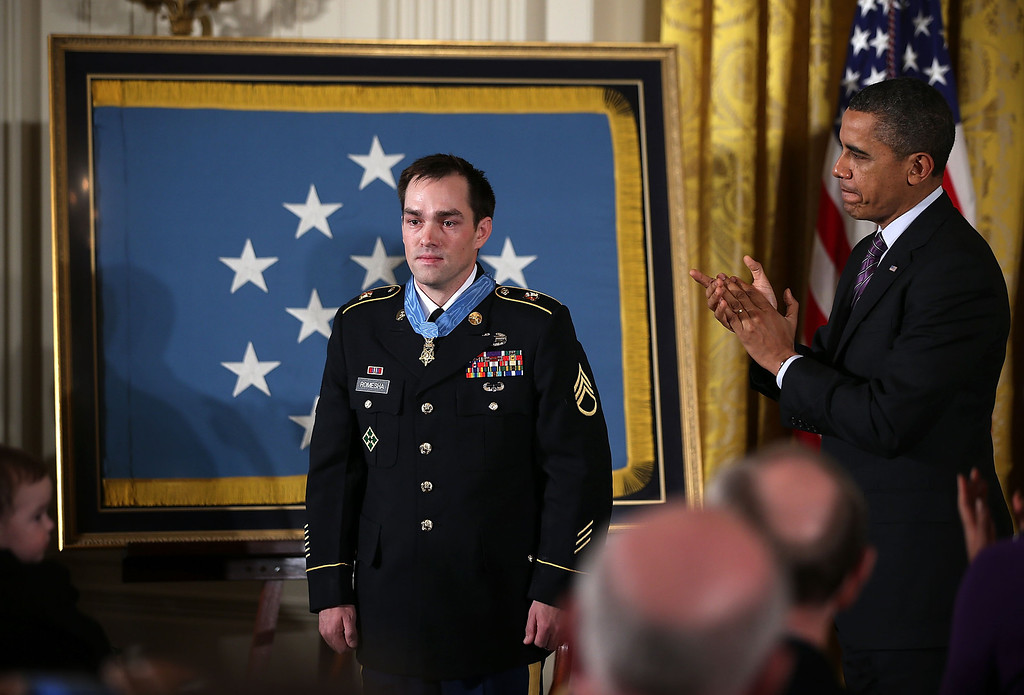 . U.S. President Barack Obama (R) applauds after he presented the Medal of Honor for conspicuous gallantry to Clinton Romesha (L), a former active duty Army Staff Sergeant, at the White House February 11, 2013 in Washington, DC.(Photo by Alex Wong/Getty Images)