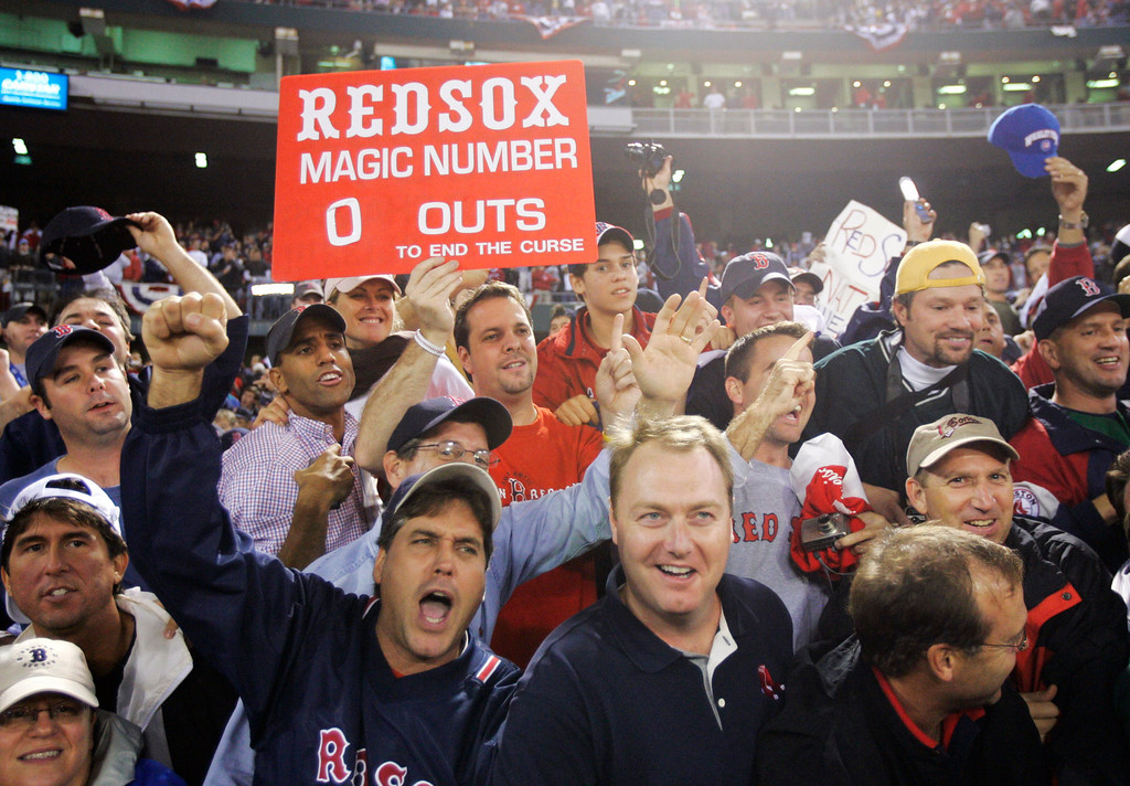 . Boston Red Sox fans celebrate the Red Sox 3-0 win over the St. Louis Cardinals to sweep the World Series Wednesday, Oct. 27, 2004, in St. Louis. (AP Photo/Al Behrman)