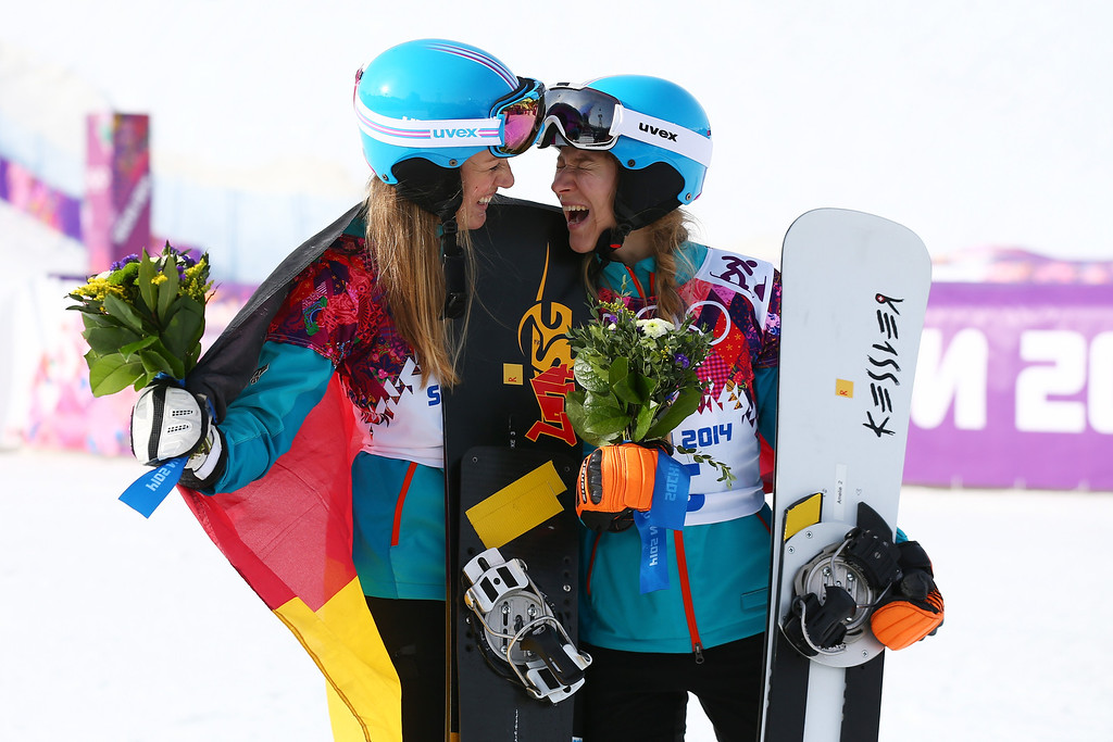 . SOCHI, RUSSIA - FEBRUARY 22:  Silver medalist Anke Karstens (L) of Germany and bronze medalist Amelie Kober of Germany celebrate in the Snowboard Ladies\' Parallel Slalom Final on day 15 of the 2014 Winter Olympics at Rosa Khutor Extreme Park on February 22, 2014 in Sochi, Russia.  (Photo by Cameron Spencer/Getty Images)