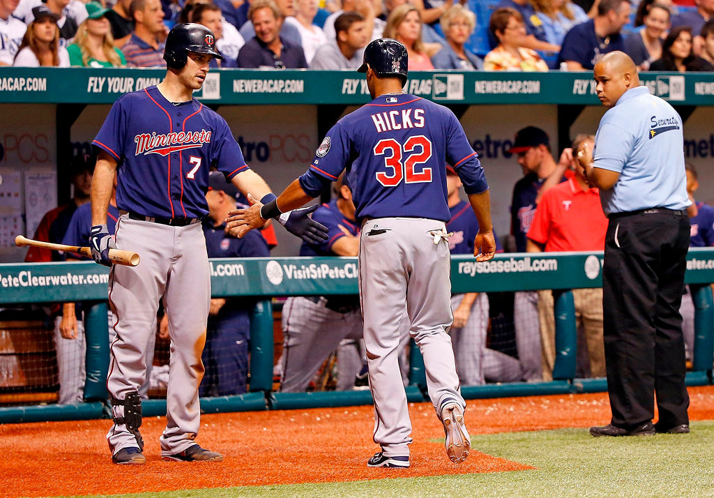 . Catcher Joe Mauer #7 of the Minnesota Twins congratulates outfielder Aaron Hicks #32 after he scored a ninth inning run against the Tampa Bay Rays. The Twins lost 7-4. (Photo by J. Meric/Getty Images)