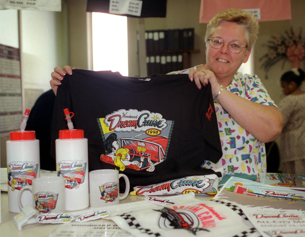 . Marsha Mellert, Recreation supervisor at Ferndale City Hall, shows off some of the Dream Cruise merchandise (T-shirts, mugs, keychains, car flags, etc) for sale at the city\'s Dept of Public Services and Recreation.