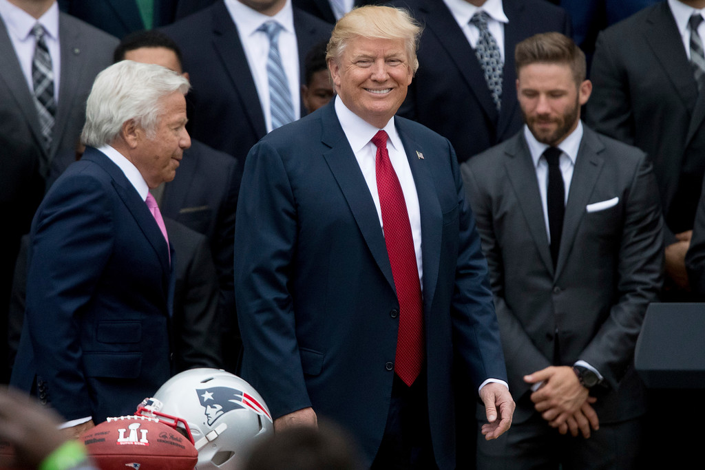 . From left, New England Patriots owner Robert Kraft, President Donald Trump, and New England wide receiver Julian Edelman, appear at a ceremony on the South Lawn of the White House in Washington, Wednesday, April 19, 2017, where the president honored the Super Bowl Champion New England Patriots for their Super Bowl LI victory. (AP Photo/Andrew Harnik)