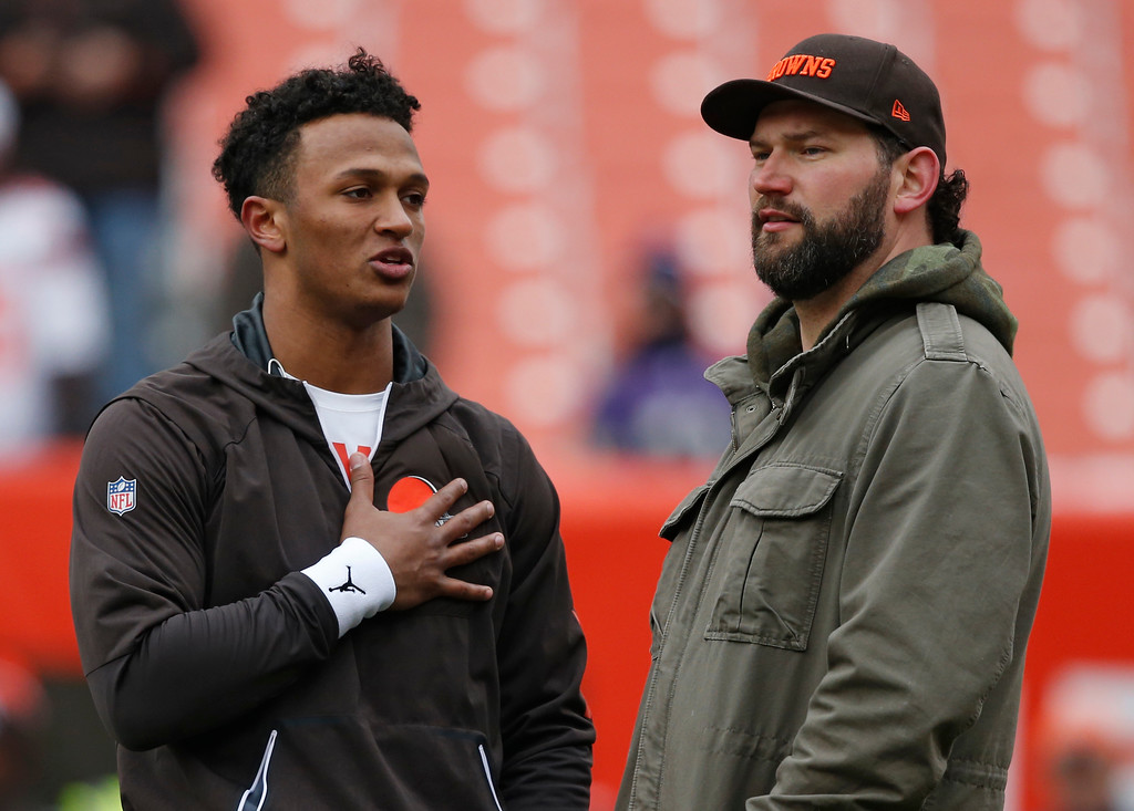 . Cleveland Browns quarterback DeShone Kizer, left, and tackle Joe Thomas talk before an NFL football game between the Baltimore Ravens and the Cleveland Browns, Sunday, Dec. 17, 2017, in Cleveland. (AP Photo/Ron Schwane)