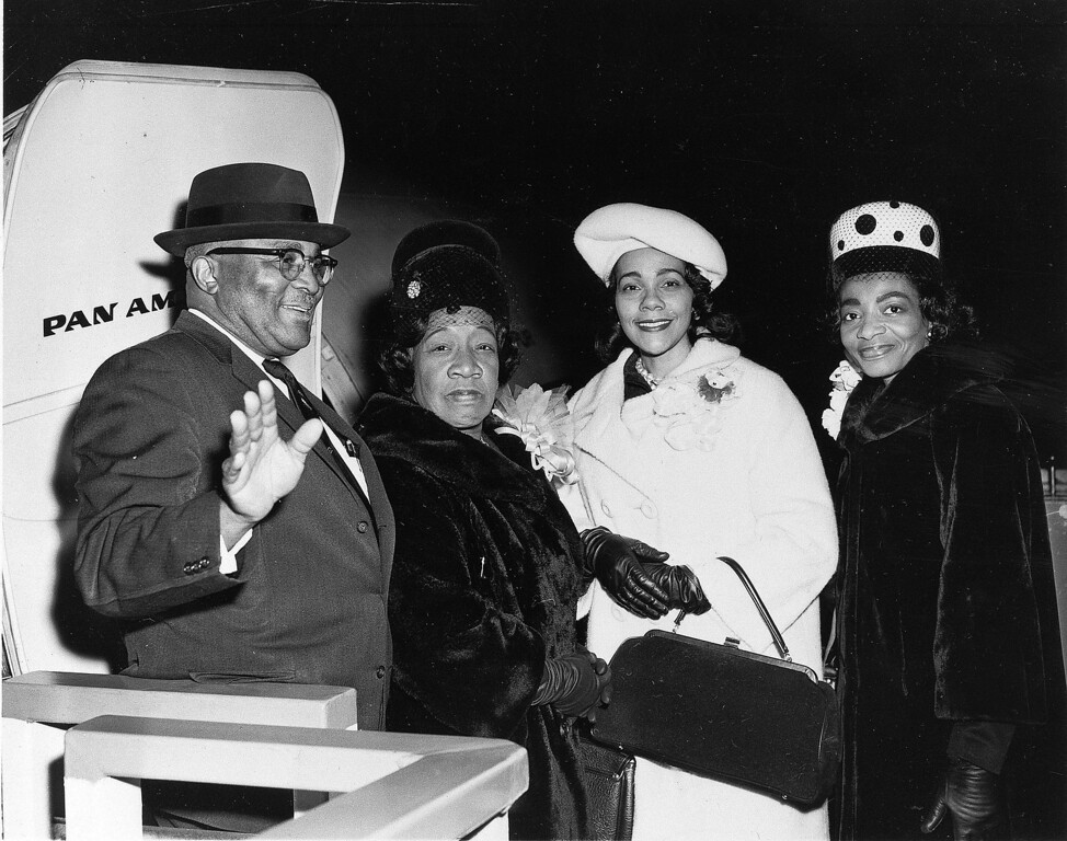 . Coretta Scott King, second from right, wife of civil rights leader Dr. Martin Luther King, Jr., prepares to board a Pan Am Clipper, Dec. 5, 1964, at Kennedy Airport in New York, en route to London to meet Dr. King, who was to receive a Nobel Peace Prize on Dec. 10.  With Mrs. King are Dr. King\'s parents, Martin Luther King, Sr. and Alberta Williams King, and at right is Christine Farris, Dr. King\'s sister.  (AP Photo)