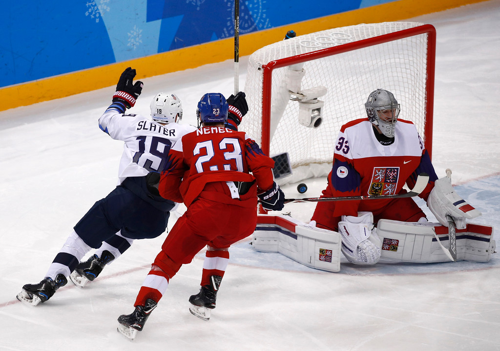 . Jim Slater (19), of the United States, celebrates after shooting the puck past goalie Pavel Francouz (33), of the Czech Republic, for a goal during the second period of the quarterfinal round of the men\'s hockey game at the 2018 Winter Olympics in Gangneung, South Korea, Wednesday, Feb. 21, 2018. (AP Photo/Jae C. Hong)