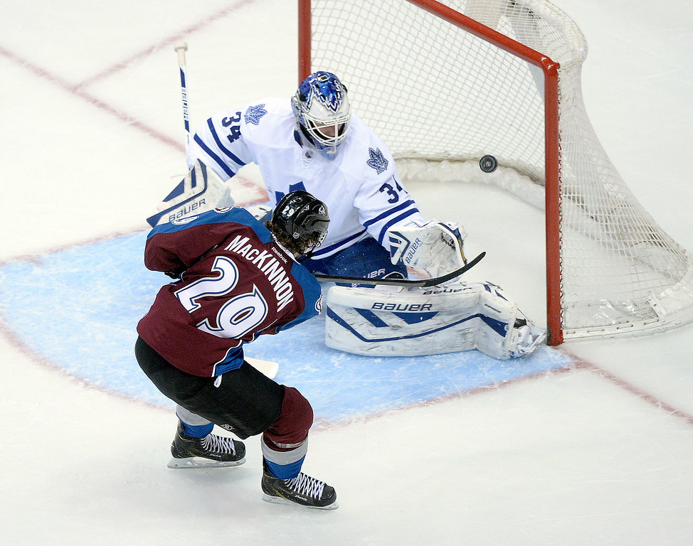 . DENVER, CO. - JANUARY 21:  Center Nathan MacKinnon (29) got the Avs on the scoreboard with a goal past Toronto goaltender James Reimer (34) in the second period. The Colorado Avalanche hosted the Toronto Maple Leafs Tuesday night, January 21, 2014 at the Pepsi Center. Photo By Karl Gehring/The Denver Post