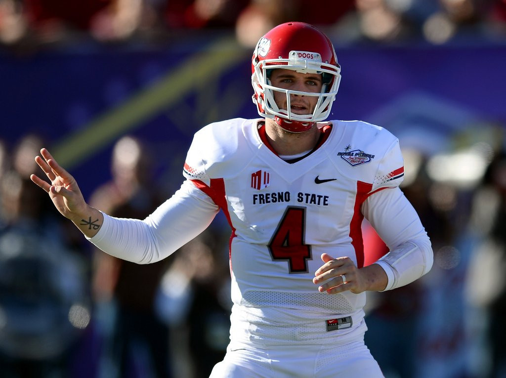 . <p><b>20. Arizona: Derek Carr, QB, Fresno State. </b> <p>If the Cardinals choose to drive a Carr over the Bridge(water), it could could be a long wait in the green room for Louisville\'s Teddy.    (Ethan Miller/Getty Images)