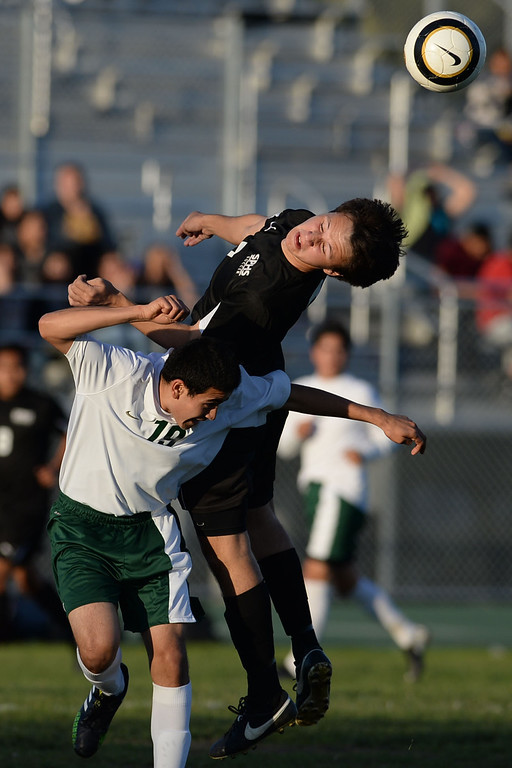 . Narbonne\'s Jose Garcia-Moreno (19) and San Pedro\'s Daniel Powell (7) battle at mid-field for the ball in a Marine League boys soccer game Wednesday, February 12, 2014, Harbor City, CA.  Narbonne won 2-0 and seals the league title. Photo by Steve McCrank/Daily Breeze