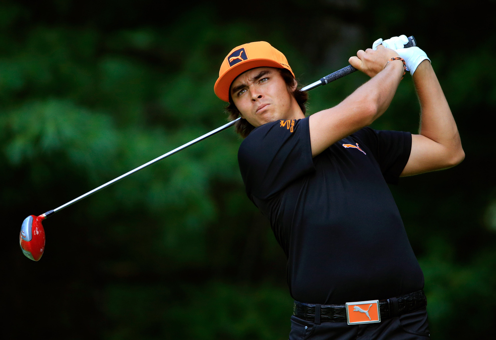 . Rickie Fowler hits off the second tee during the Final Round of the World Golf Championships-Bridgestone Invitational at Firestone Country Club South Course on August 4, 2013 in Akron, Ohio.  (Photo by Sam Greenwood/Getty Images)