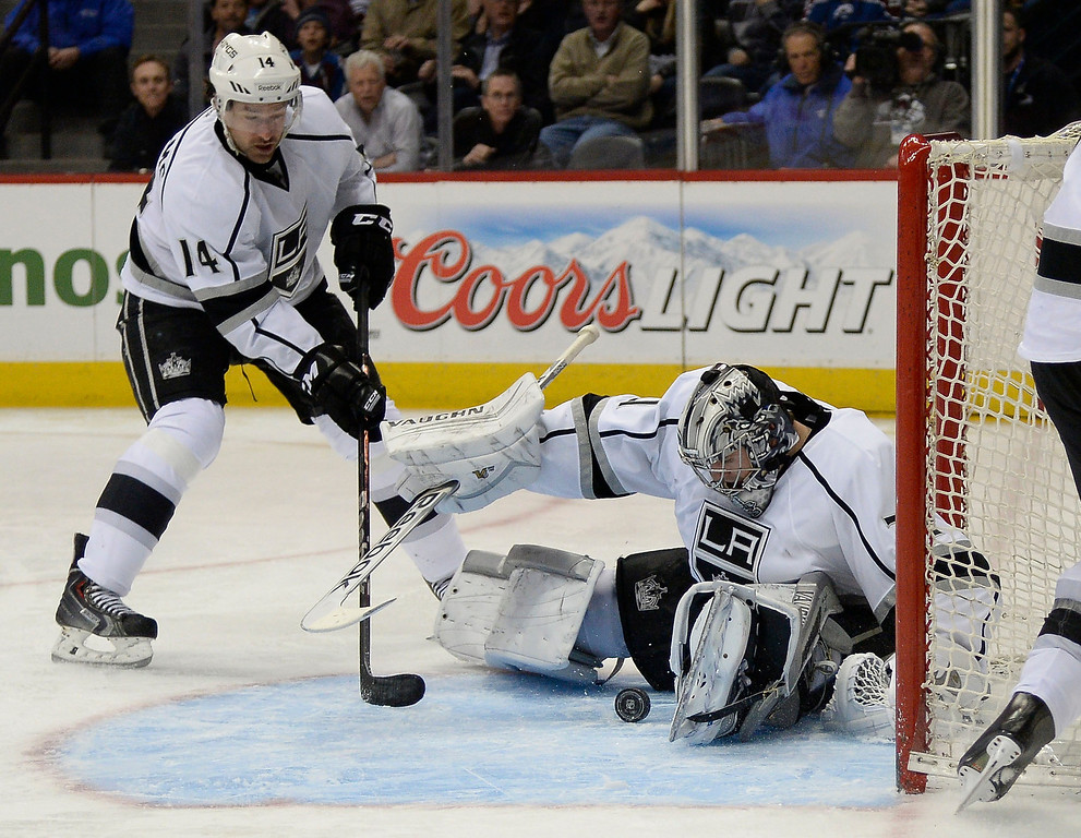 . DENVER, CO - FEBRUARY 27: Los Angeles Kings goalie Martin Jones (31) makes a save on a shot by Colorado Avalanche left wing Jamie McGinn (11) not  pictured, during the third period February 27, 2014 at Pepsi Center. Also in on the frame is Los Angeles Kings right wing Justin Williams (14). (Photo by John Leyba/The Denver Post)