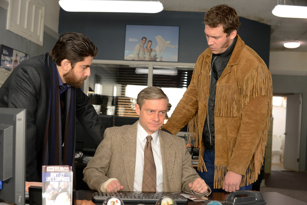 """. In this image released by FX, from left, Adam Goldberg, Martin Freeman and Russell Harvard appear in a scene from \""""Fargo.\"""" The show was nominated for a Golden Globe for best TV movie or mini-series on Thursday, Dec. 11, 2014. The 72nd annual Golden Globe awards will air on NBC on Sunday, Jan. 11. (AP Photo/FX, Chris Large)"""