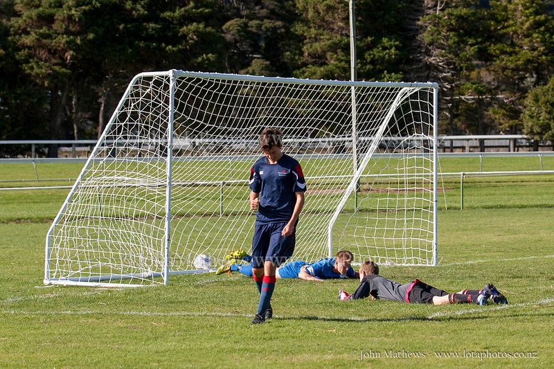 Action from the First XI football match between HIBs and Tawa College played at HIBs , Upper Hutt, New Zealand on 9 May 2015. Copyright: John Mathews +64 2744 54321