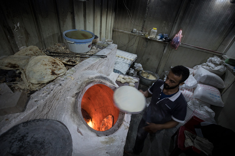 Baking flatbread at a restaurant in Baghdad.