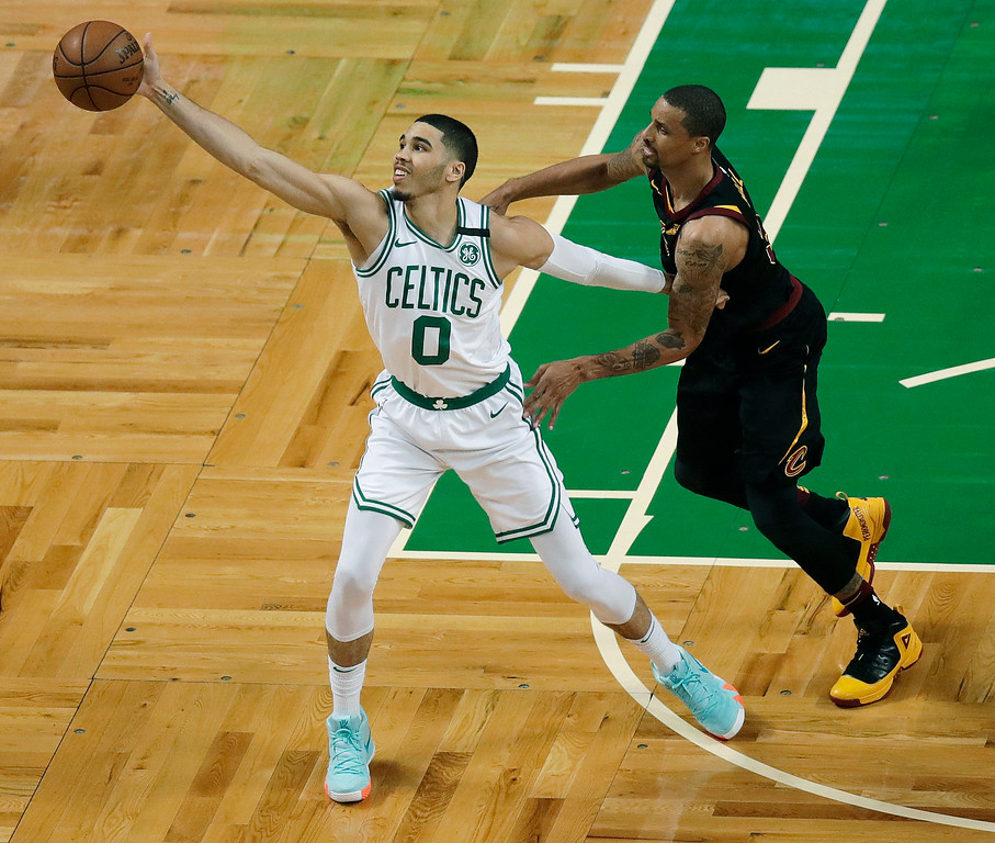 . Boston Celtics forward Jayson Tatum, left, catches the ball in front of Cleveland Cavaliers guard George Hill, right, during the first half in Game 7 of the NBA basketball Eastern Conference finals, Sunday, May 27, 2018, in Boston. (AP Photo/Charles Krupa)