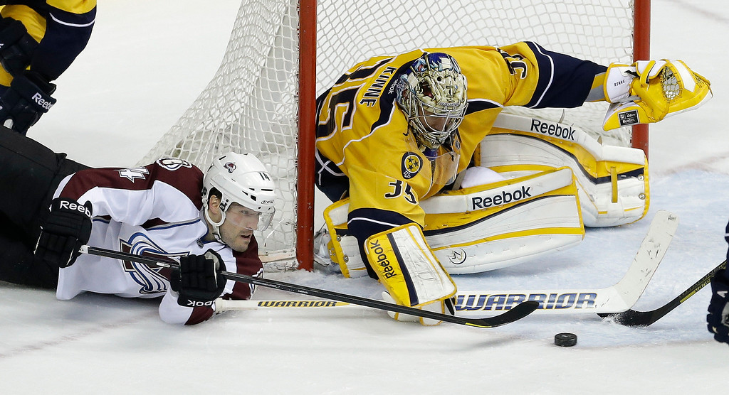 . Nashville Predators goalie Pekka Rinne (35), of Finland, blocks a shot by Colorado Avalanche right wing David Van der Gulik (14) during the third period of an NHL hockey game Tuesday, April 2, 2013, in Nashville, Tenn. The Predators won 3-1. (AP Photo/Mark Humphrey)