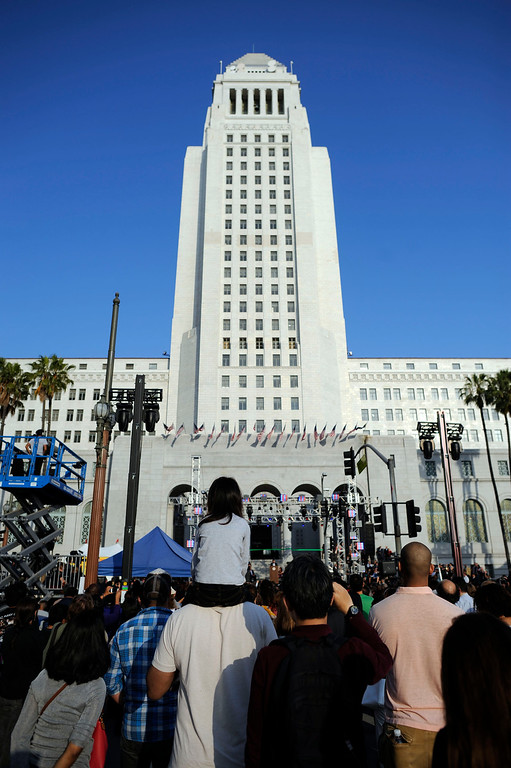 . People listen to speakers at CelebrateLA! on the steps of city hall Friday, June 7, 2013. (Hans Gutknecht/L.A. Daily News)