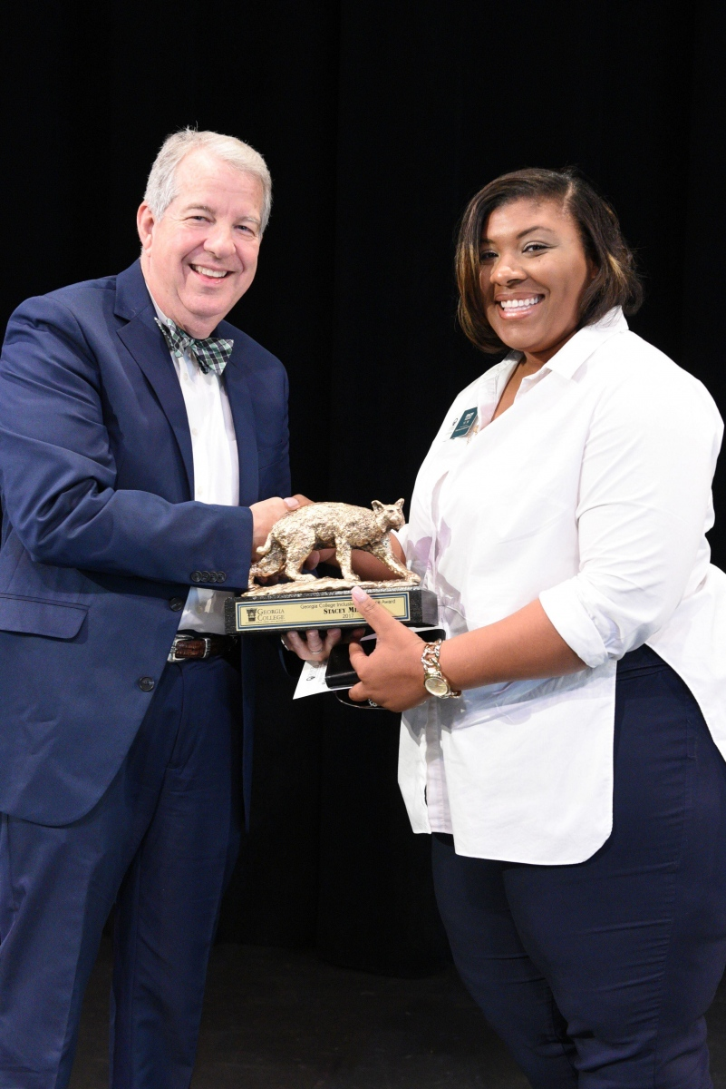 President Steve Dorman presenting the 2017 Georgia College Inclusive Excellence Award to Milner.