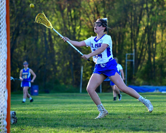 5/8/2019 Mike Orazzi | Staff St. Paul Catholic High School's Cameron Baston (24) during Wednesday's girls lacrosse with Housatonic Regional in Bristol.