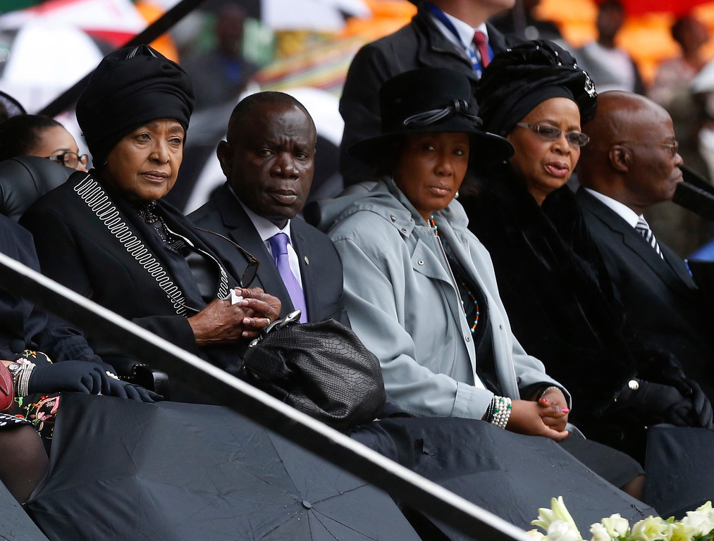 . Nelson Mandela\'s widow Graca Machel, right, and his former wife Winnie MadikizelañMandela, left, sit on stage during the memorial service for former South African president Nelson Mandela at the FNB Stadium in Soweto near Johannesburg, Tuesday, Dec. 10, 2013. (AP Photo/Matt Dunham)