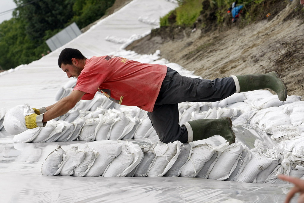 . Local residents pile up sand bags to enforce the dam against the floods of the river Danube in Mecser some 150 kilometers west from the Hungarian capital Budapest on June 5, 2013. Hungary is preparing to face its worst flooding in 50 years as heavy rainfall continued to spread havoc across Central Europe. Hungarian Prime Minister Viktor Orban declared a state of alert as waters surge in the mighty Danube, which is also threatening cities in Austria.  AFP PHOTO / FERENC  ISZA/AFP/Getty Images
