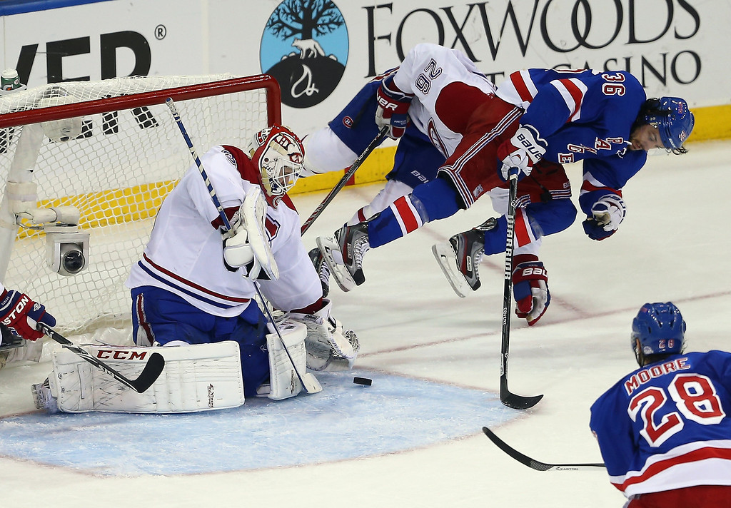 . Dustin Tokarski #35 of the Montreal Canadiens makes a save against Mats Zuccarello #36 of the New York Rangers in Game Three of the Eastern Conference Final during the 2014 NHL Stanley Cup Playoffs at Madison Square Garden on May 22, 2014 in New York City.  (Photo by Elsa/Getty Images)