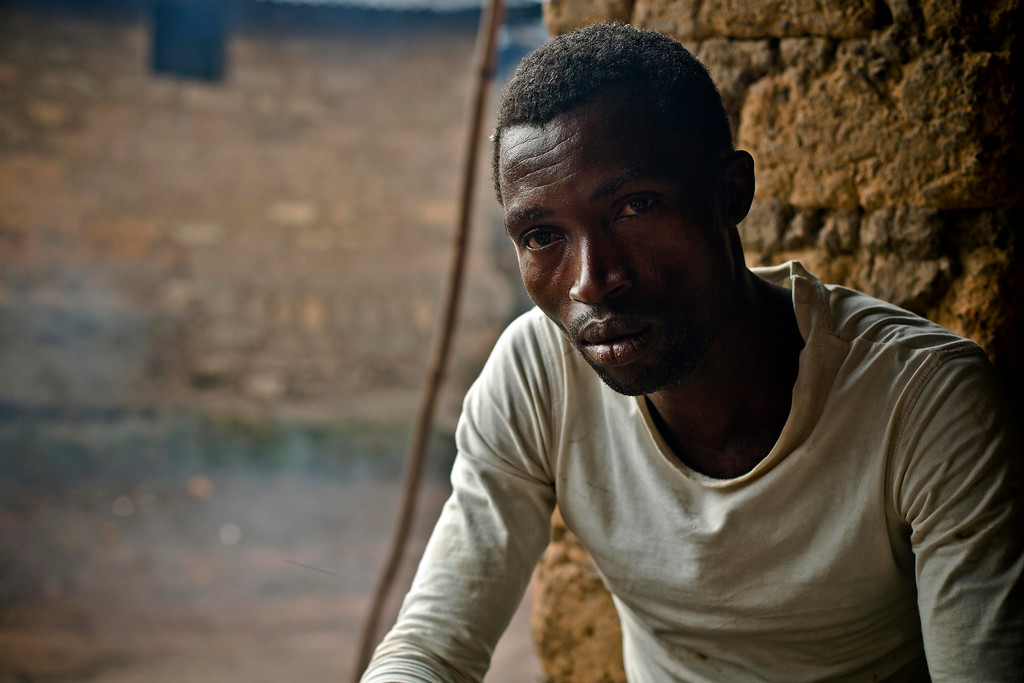 . In this photo taken Sunday, Nov. 23, 2014, Lansana Kamano, sits in the Guinean village of Meliandou, some 400 miles (600 kms) south-east of Conakry, Guinea, believed to be Ebola\'s ground zero. (AP Photo/Jerome Delay)