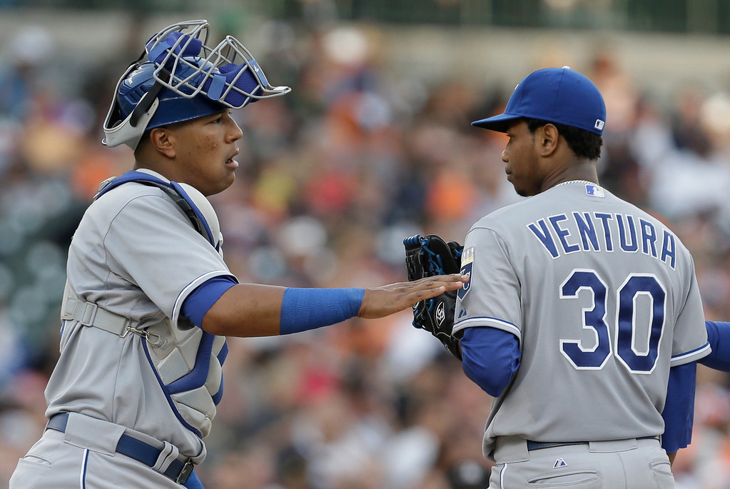 . Kansas City Royals catcher Salvador Perez, left, talks with pitcher Yordano Ventura (30) against the Detroit Tigers in the second inning of a baseball game in Detroit, Tuesday, June 17, 2014.  (AP Photo/Paul Sancya)
