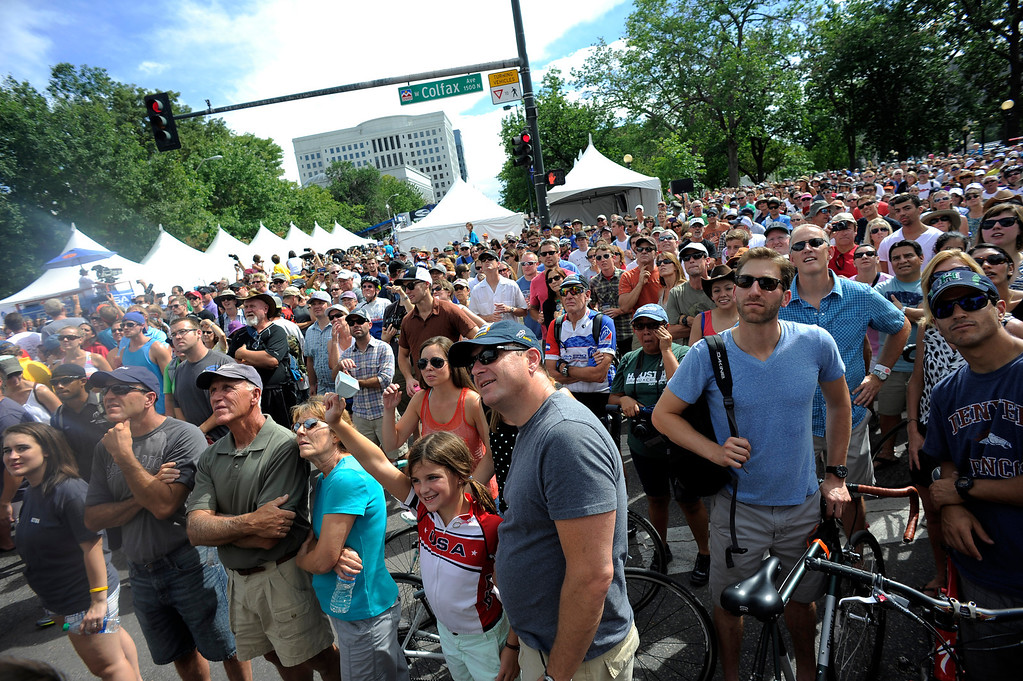 . Fans watch the final lap of the USA Pro Cycle Challenge as it makes it way through downtown Denver August 25, 2013. Aspen\'s Tejay van Garderen won the 3rd annual Pro Cycle Challenge. (Photo by John Leyba/The Denver Post)