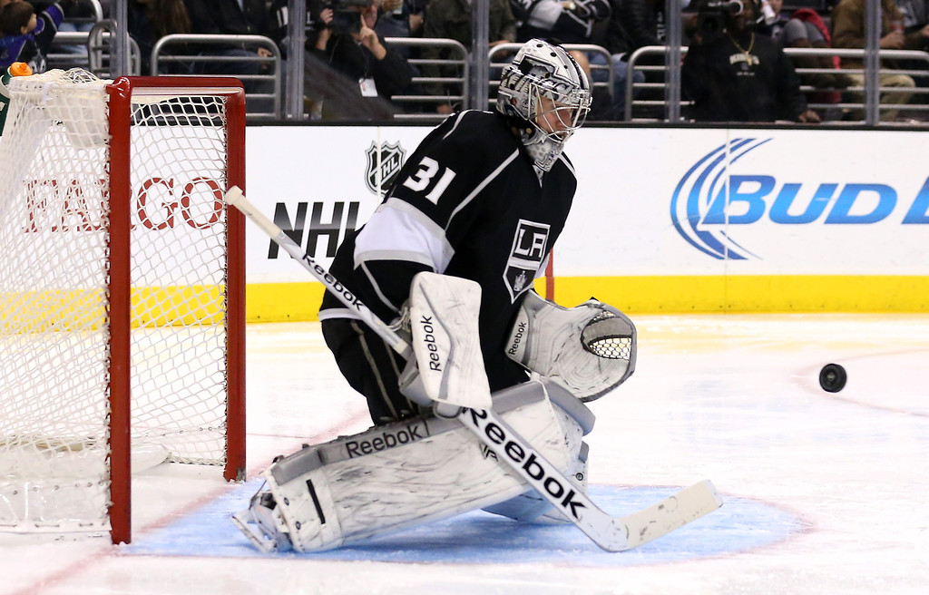 . LOS ANGELES, CA - DECEMBER 21:  Goalie Martin Jones #1 of the Los Angeles Kings stops a shot against the Colorado Avalanche at Staples Center on December 21, 2013 in Los Angeles, California.  The Kings won 3-2 on a shootout.  (Photo by Stephen Dunn/Getty Images)