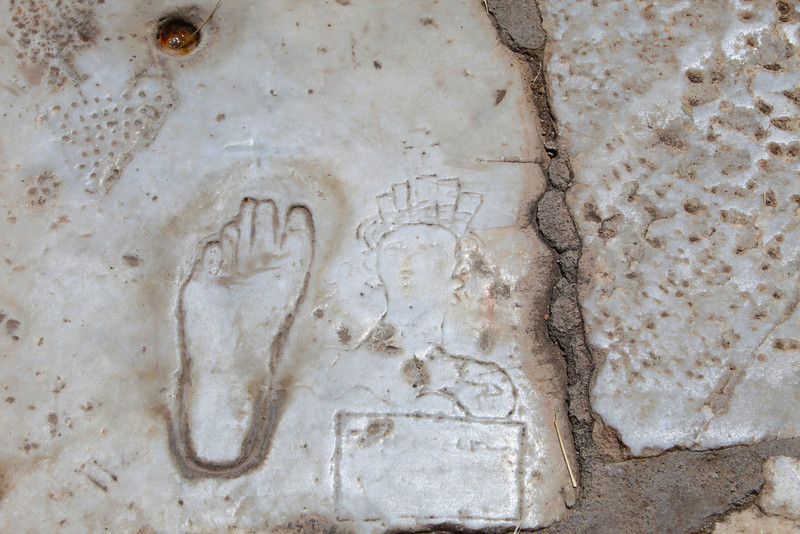 On Marble Street, a carved footprint to show the way to the Brothel