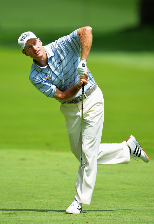 . ROCHESTER, NY - AUGUST 08: Jim Furyk of the United States reacts to his approach shot on the eighth hole during the first round of the 95th PGA Championship on August 8, 2013 in Rochester, New York.  (Photo by Stuart Franklin/Getty Images)
