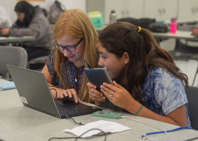 Alise Evans (left) and Sabine Tovar work together to code an app during the Girls Code Camp.  Click on the link for more info about TAMU-CC's Summer Camps: http://bit.ly/2MighNt