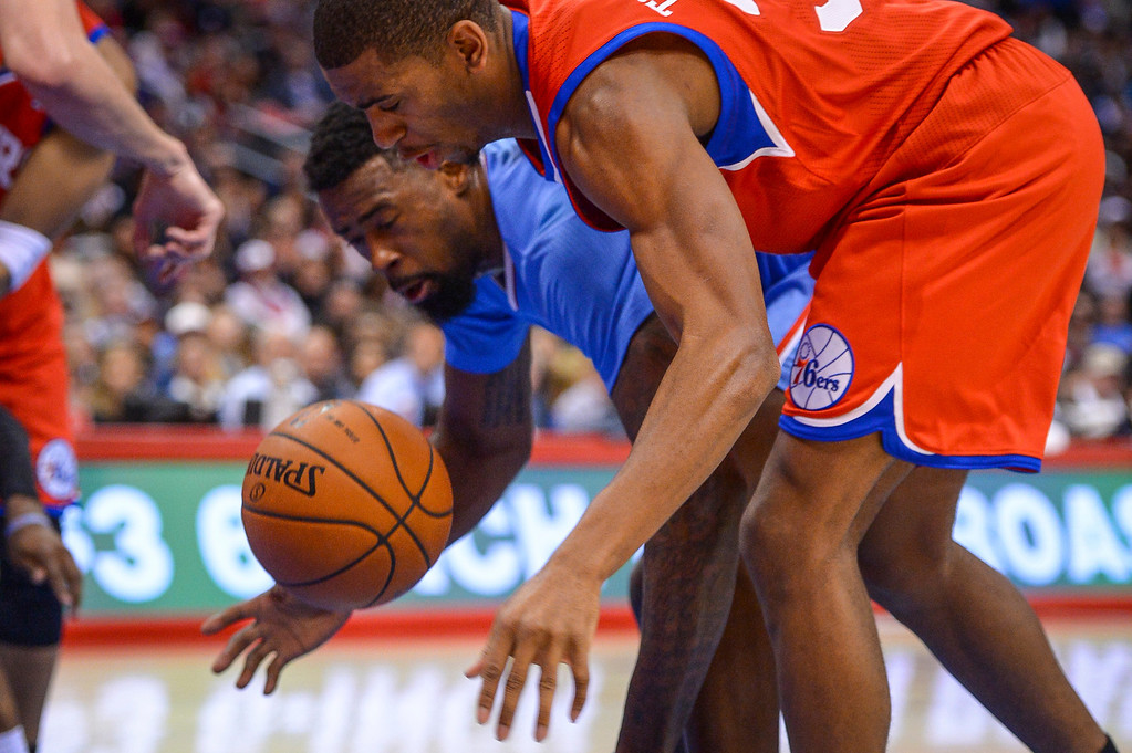 . Clippers� DeAndre Jordan and 76ers� Hollis Thompson battle for the ball  during first half action at Staples Center Sunday.  ( Photo by David Crane/Los Angeles Daily News )