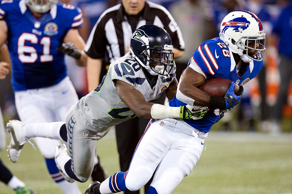 . Buffalo Bills running back C.J. Spiller (28) rushess as he is tackled by Seattle Seahawks cornerback Jeremy Lane (20) during the first half of an NFL football game, Sunday, Dec. 16, 2012, in Toronto. (AP Photo/The Canadian Press, Frank Gunn)