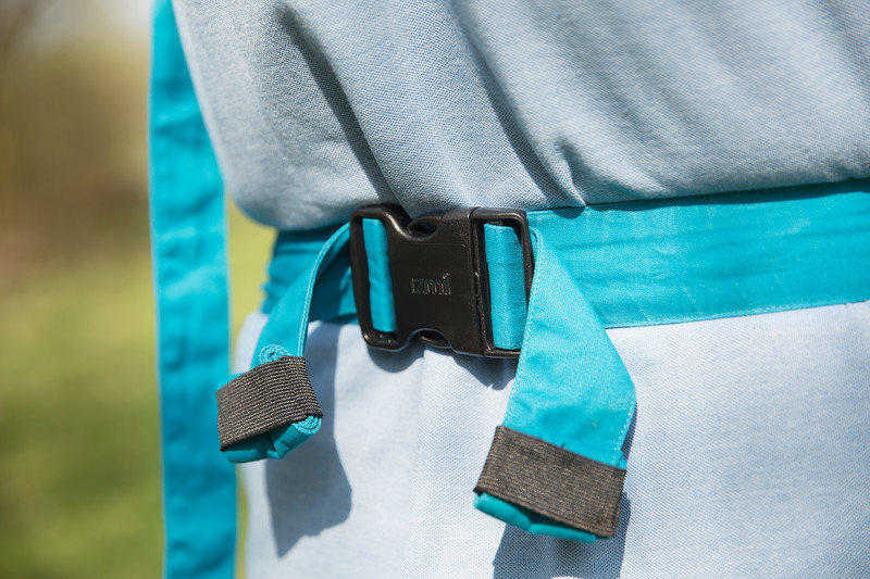 Izmi_Baby_Carrier_Cotton_Teal_Lifestyle_Front_Carry_Waistband.jpg