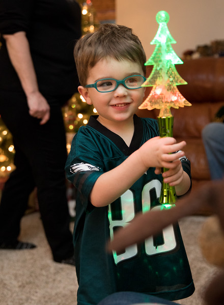 Caleb with Light up Christmas Tree Wand.jpg