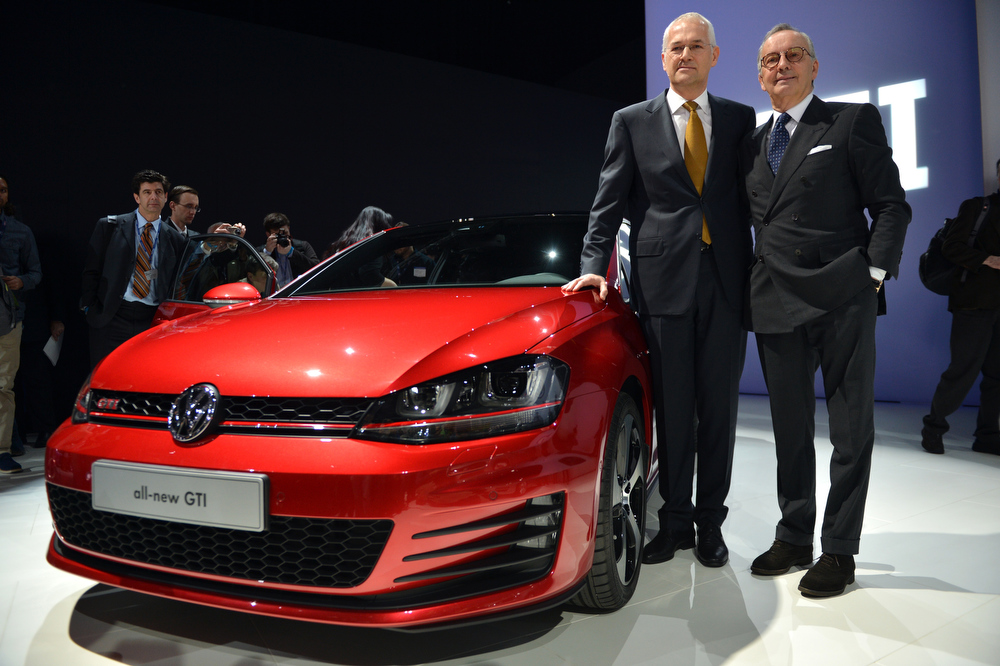 Description of . Jonathan Browning (L), President and CEO Volkswagen Group of America and Walter de Silva, Head of Group Design Volkswagen AG stand by a  Volkswagen GTI during the first press preview day at the New York International Automobile Show March 27, 2013 in New York.  STAN HONDA/AFP/Getty Images