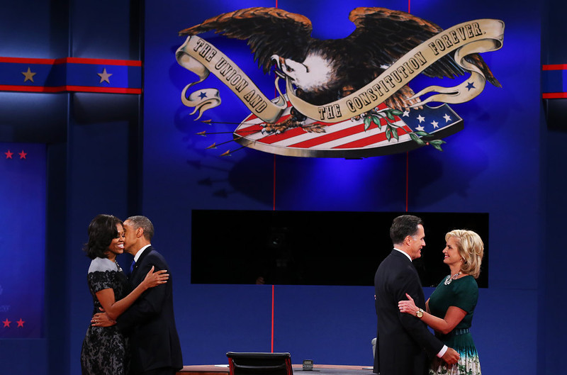 ". U.S. President Barack Obama (2L) and first lady Michelle Obama (L) stand on stage with Republican presidential candidate Mitt Romney and wife, Ann Romney after the debate at the Keith C. and Elaine Johnson Wold Performing Arts Center at Lynn University on October 22, 2012 in Boca Raton, Florida. The focus for the final presidential debate before Election Day on November 6 is foreign policy. ""Presidential Debate\"" ranked as Google\'s sixth most searched trending event of 2012. (Photo by Joe Raedle/Getty Images)"