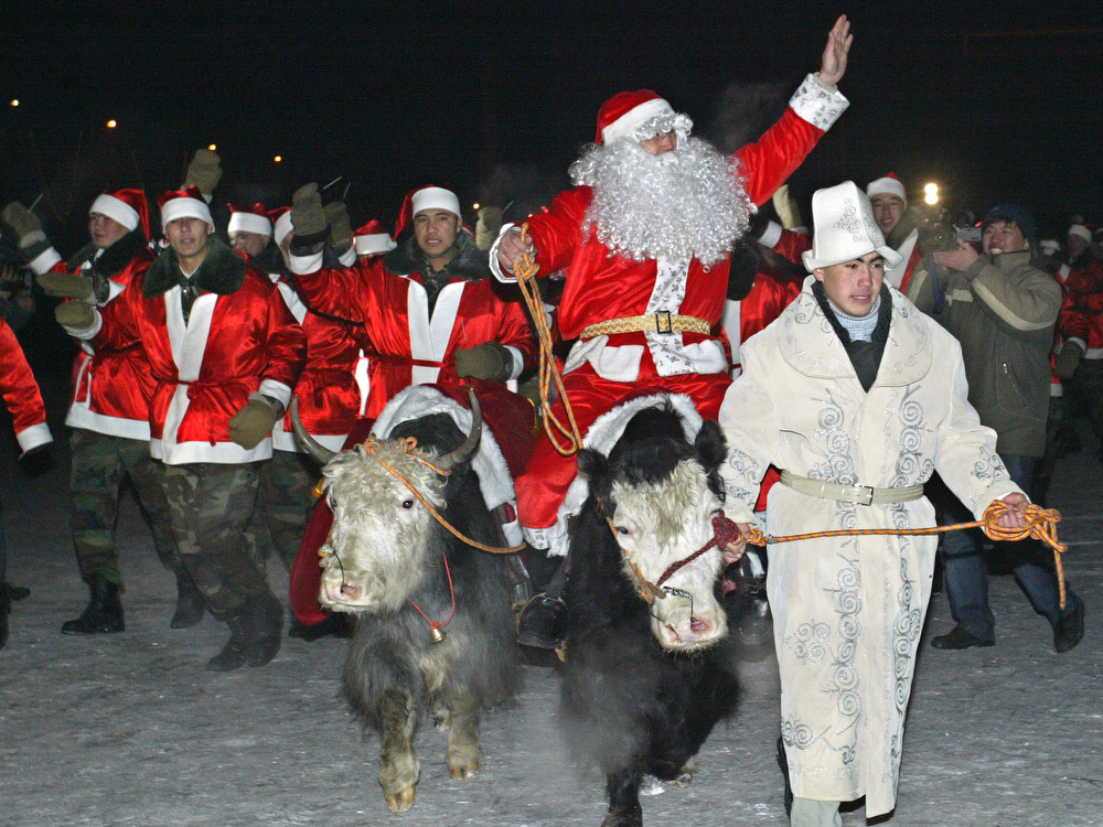 Description of . Kyrgyz Father Frosts (the Russian name for Santa Claus) ride yaks as they take part in a New Year parade in Bishkek, 30 December 2007. AFP PHOTO / VYACHESLAV OSELEDKO