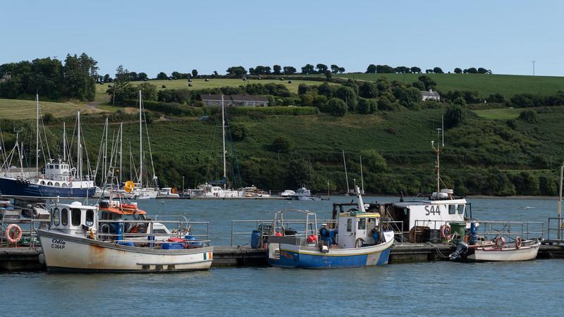 View of sailboats moored at harbor, Kinsale, County Cork, Ireland