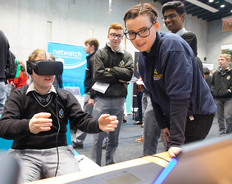 "09/11/2017. Crystal Valley Tech Showcase at WIT Arena. Pictured is Daniel Lynch from St Kieran's College, Kilkenny with Anna Cintulova from Bluefin with a VR Head Set. Picture: Patrick Browne  Event demonstrates Tech and ICT is thriving in the South East 50 companies and 2,000 students, industry and recruiters attend the inaugural Crystal Valley Tech Showcase event  The future is bright for ICT in the South East according to Dr Padraig Kirwan, Head of the Department of Computing & Mathematics at Waterford Institute of Technology. ""Computing is thriving in the South East judging by the number and diversity of ICT companies here today. Even more encouraging is the number of second level students who attended from Waterford, Kilkenny, Carlow, Tipperary and Wexford and how interested they are about the career opportunities in this exciting industry.""  Over 50 companies who are working together as Crystal Valley Tech showcased their rapidly growing industry in the WIT Arena on Thursday morning to approx. 2,000 members of the public, college and second level students, recruiters, government agencies and other industry.  Elaine Fennelly, Bluefin Payment Systems General Manager and co-founder of Crystal Valley Tech is very excited about the industry in the South East and today's showcase event. ""People who work in the industry already know that Tech is well established in the South East and the number of opportunities and companies continues to grow and grow. According to a recent Tech Ireland report there are over 60 indigenous and multinational companies employing well over 1,500 people from their bases in Waterford, Wexford, Kilkenny and Carlow.  ""However, we weren't so sure that people in the region realised just how big the ICT industry is becoming and to ensure the industry's future growth in the South East a group of us came together to form Crystal Valley Tech. Our remit is fairly simple, to create a Tech hub in the South East to which international"