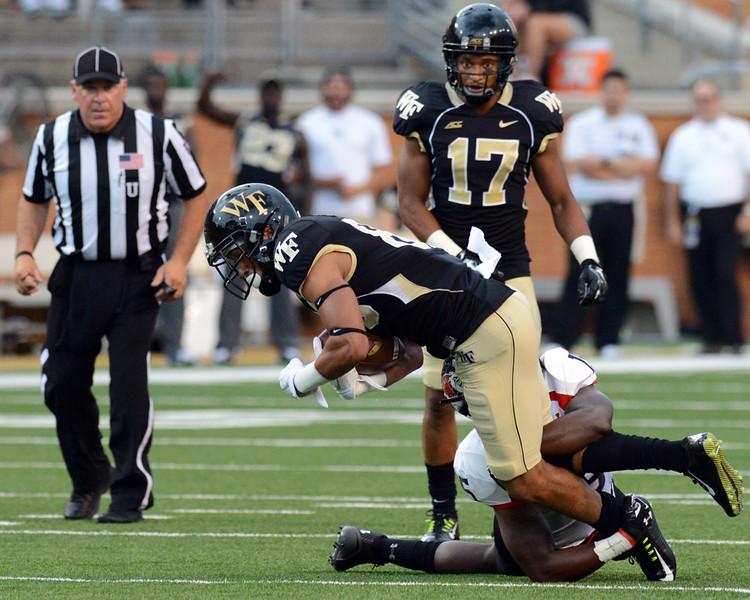 Jared Crump tackled ater catch.jpg