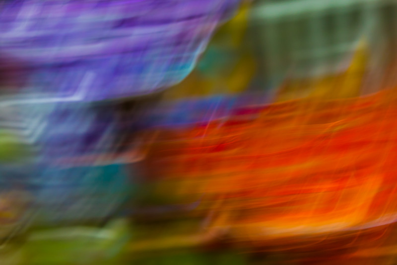 Harsh stabs of orange, red, purple and green make stiff movements in an abstract way.