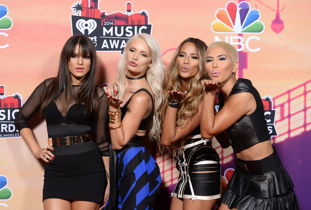 . LOS ANGELES, CA - MAY 01:  (L-R) Natasha Slayton, Lauren Bennett, Emmalyn Estrada and Paula Van Oppen of G.R.L pose in the press room during the 2014 iHeartRadio Music Awards held at The Shrine Auditorium on May 1, 2014 in Los Angeles, California. iHeartRadio Music Awards are being broadcast live on NBC.  (Photo by Jason Merritt/Getty Images for Clear Channel)