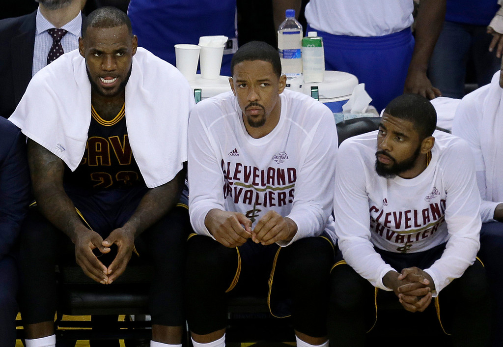 . Cleveland Cavaliers forward LeBron James, from left, sits on the bench with center Tristan Thompson and guard Kyrie Irving during the second half of Game 1 of basketball\'s NBA Finals against the Golden State Warriors in Oakland, Calif., Thursday, June 1, 2017. (AP Photo/Ben Margot)