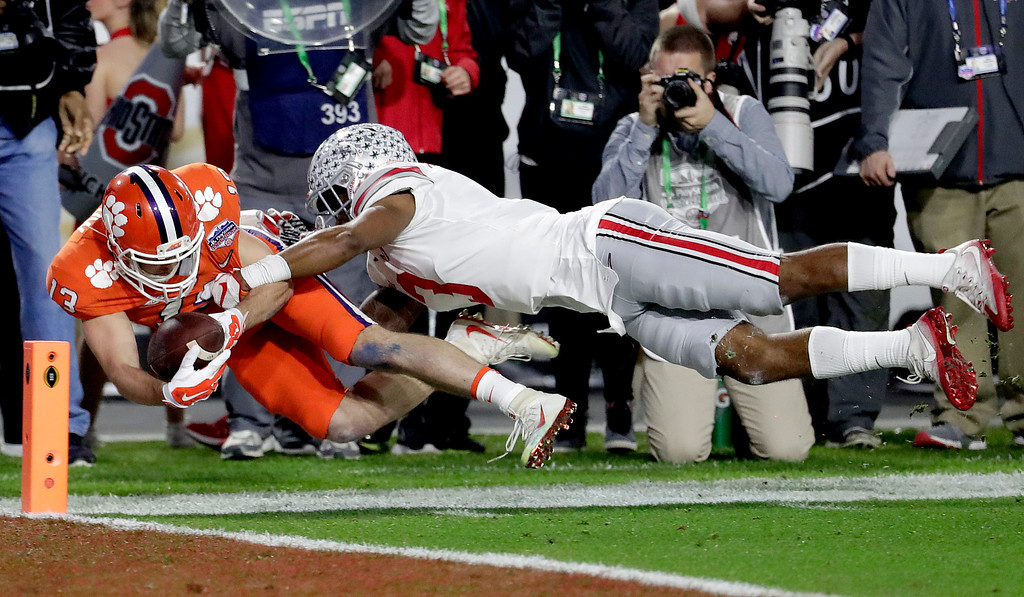 . Clemson wide receiver Hunter Renfrow (13) is tackled short of the goal line by Ohio State cornerback Damon Arnette (3) during the first half of the Fiesta Bowl NCAA college football game, Saturday, Dec. 31, 2016, in Glendale, Ariz. (AP Photo/Rick Scuteri)